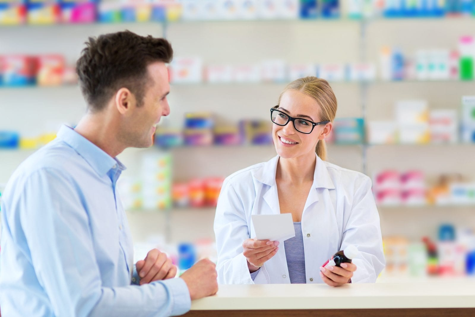 bigstock Pharmacist and client at pharm 129268391